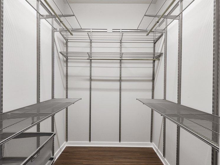 Huge walk-in closet with shelves and organizers in luxury apartment for rent in Wynnewood, PA