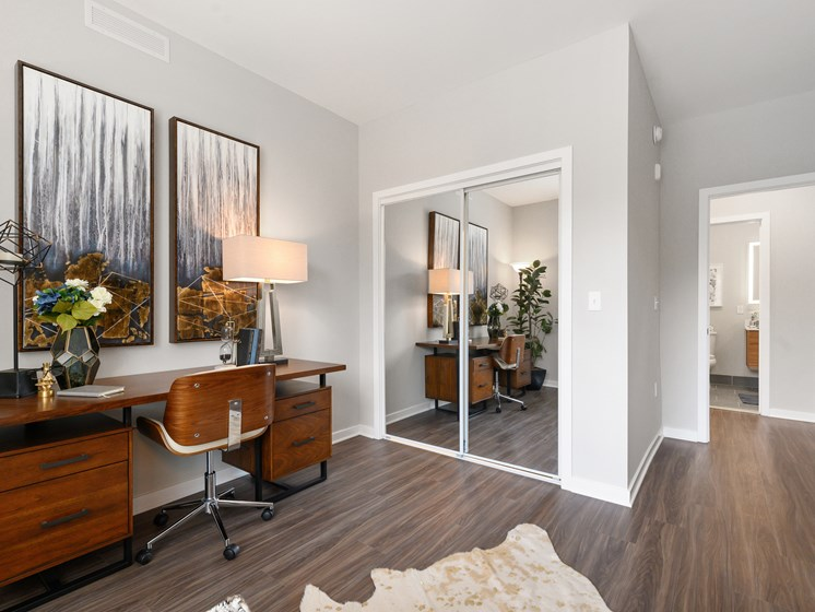 Work from home room with mirrored closet doors and vinyl flooring in luxury apartment outside of Philadelphia