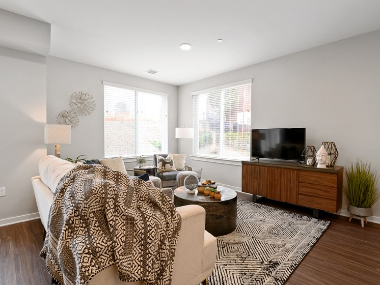 Furnished living area in The Palmer West boutique apartment with large windows