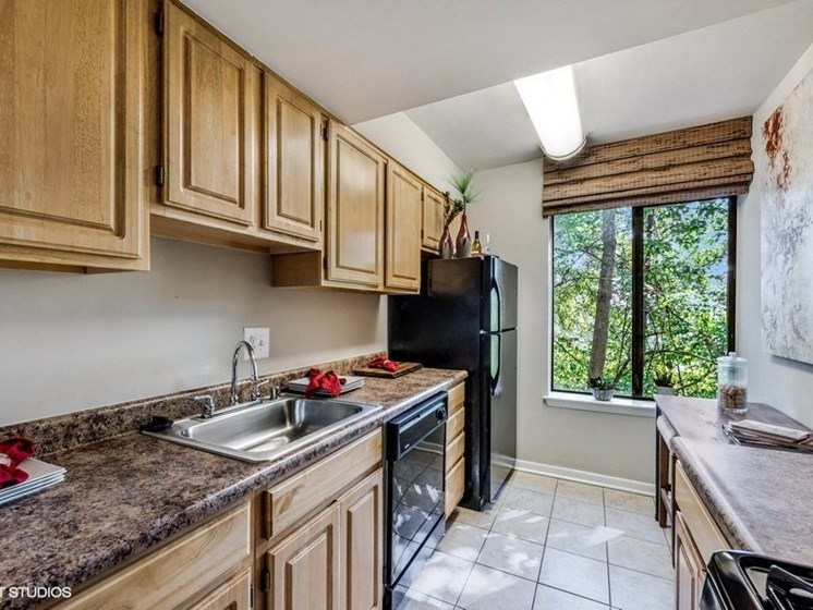 Updated Kitchen With Black Appliances at Brookland Ridge Apartments, Washington