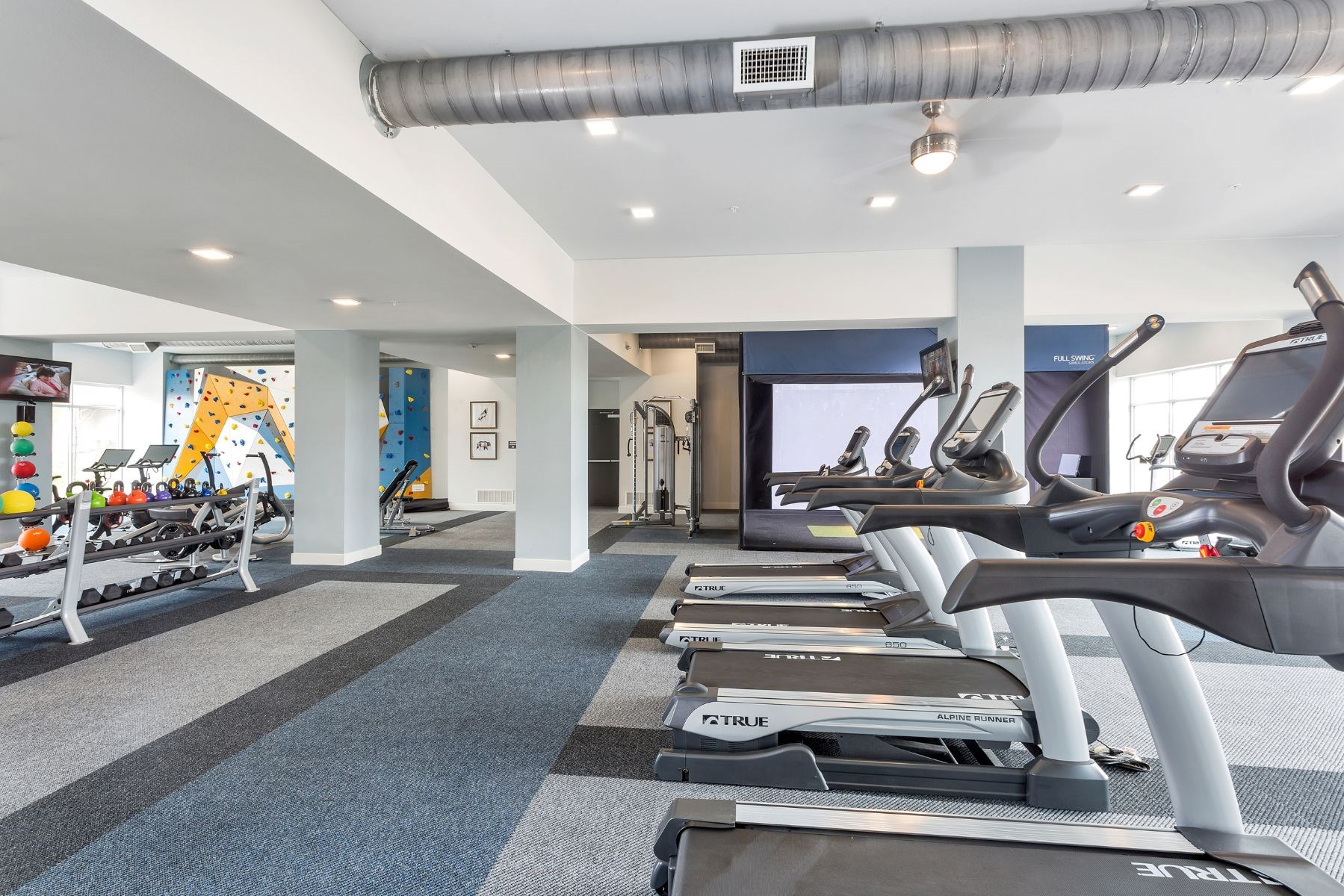 Westwood Green Apartments Fitness Center cardio equipment including treadmills and elypticals