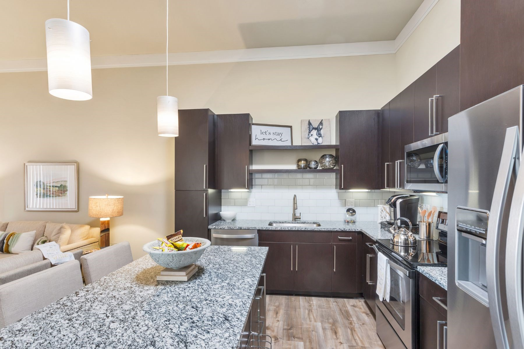 Westwood Green Apartments Kitchen with large island, stainless appliances, and quartz countertops