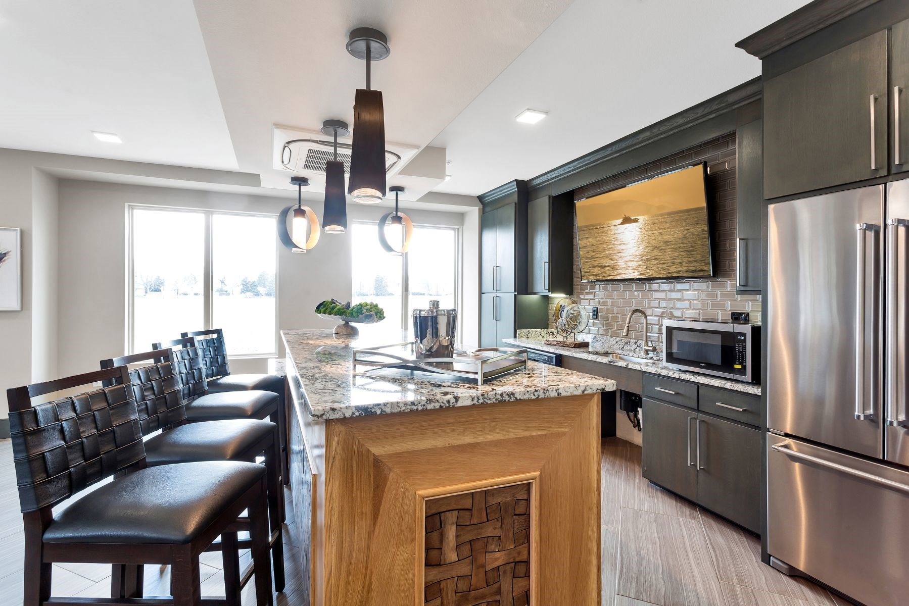 Westwood Green Apartments Clubhouse full demonstration kitchen with stainless appliances and bar height countertop
