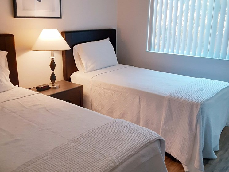 furnished apartment bedroom with two twin beds_Southwest Village Apartments, Reno, NV