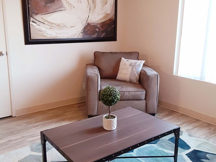 Furnished living room area coffee table and love seat_Southwest Village Apartments, Reno, NV
