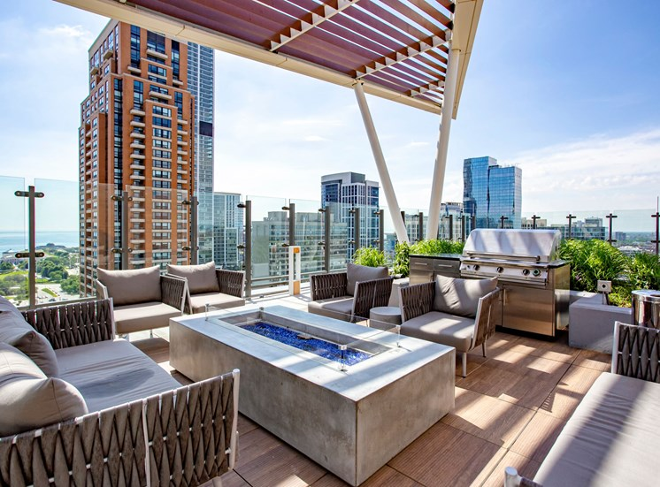 Rooftop lounge aread with chairs & outdoor fire pit at Eleven40, Illinois