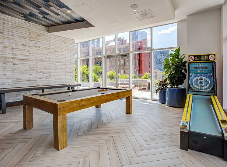 Game room with shuffleboard, skee-ball and pool table at Eleven40, Chicago, Illinois
