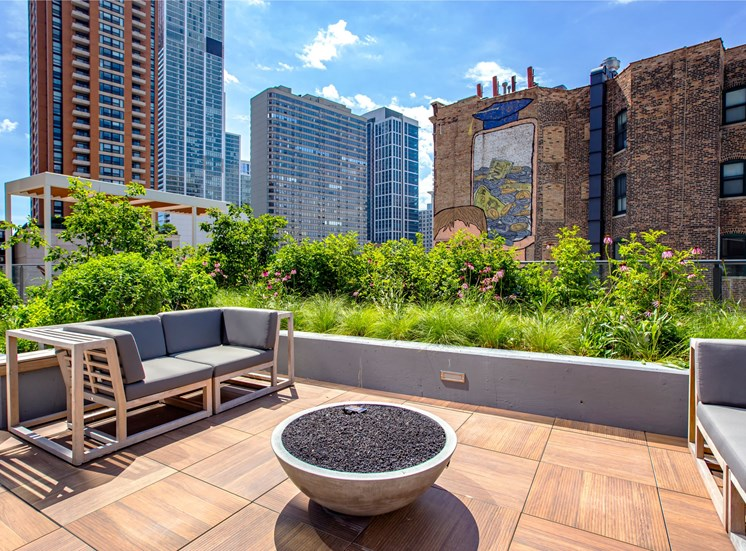 Outdoor deck with seating surrounding fire pit at Eleven40, Chicago