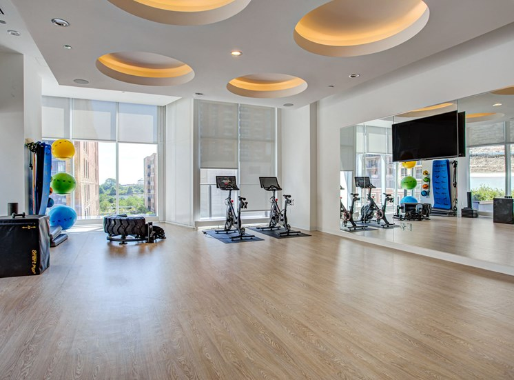 Yoga studio with Peloton bikes and other Fitness On Demand options at Eleven40, Illinois, 60605