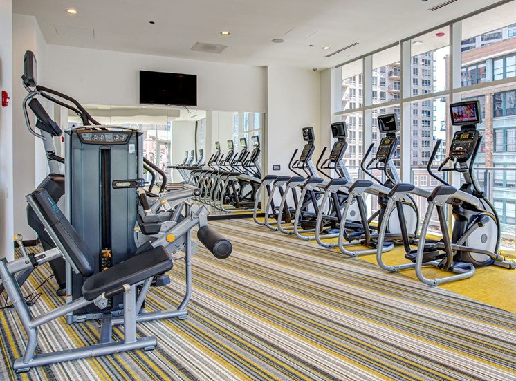 Fitness center with cardio and strength training equipment at Eleven40, Chicago, IL, 60605
