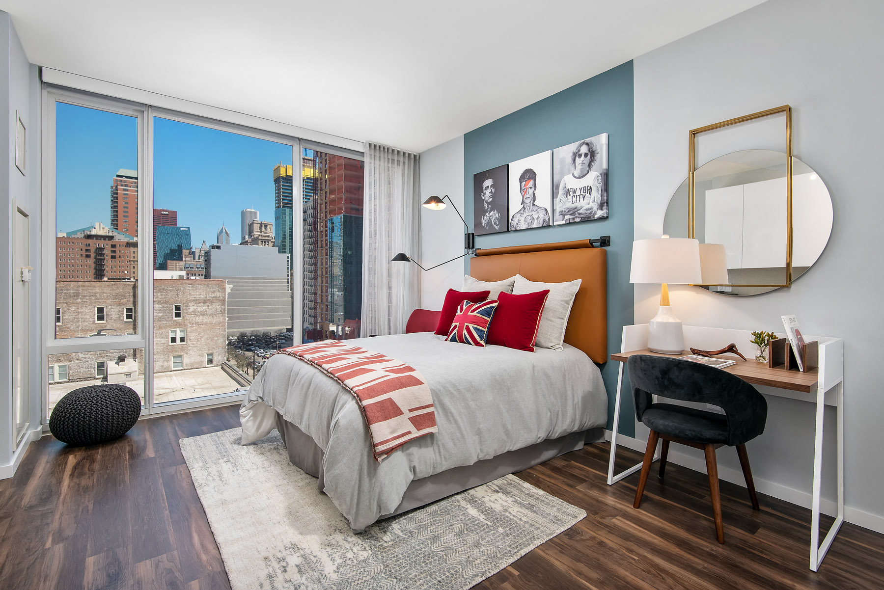 Furnished studio bedroom with floor to ceiling windows at Eleven40, Chicago, IL