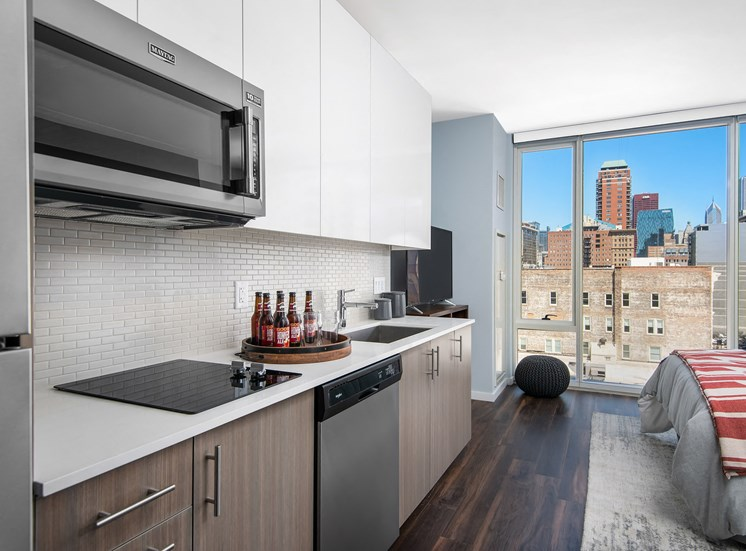 Studio open layout with floor to ceiling windows at Eleven40, Chicago, 60605