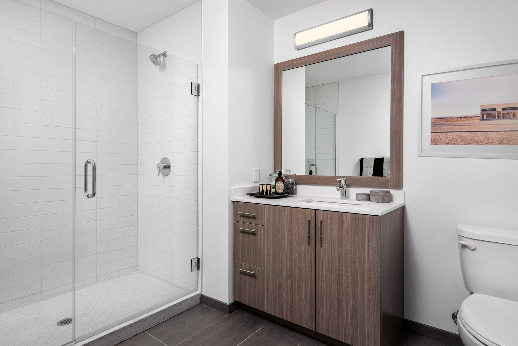 Modern upgraded bathroom with walk-in shower at Eleven40, Chicago, Illinois