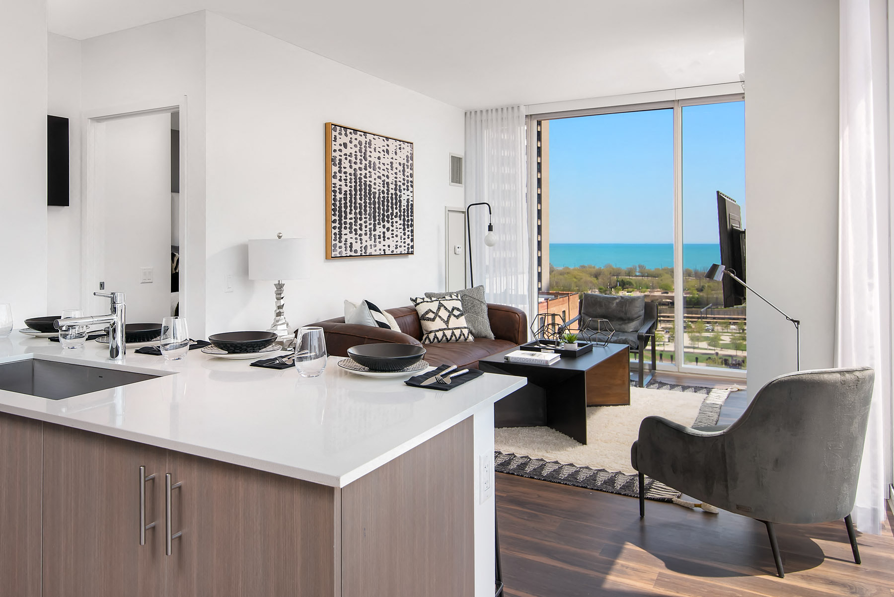 Two bedroom living room with open floor plan and floor to ceiling windows at Eleven40, Illinois, 60605