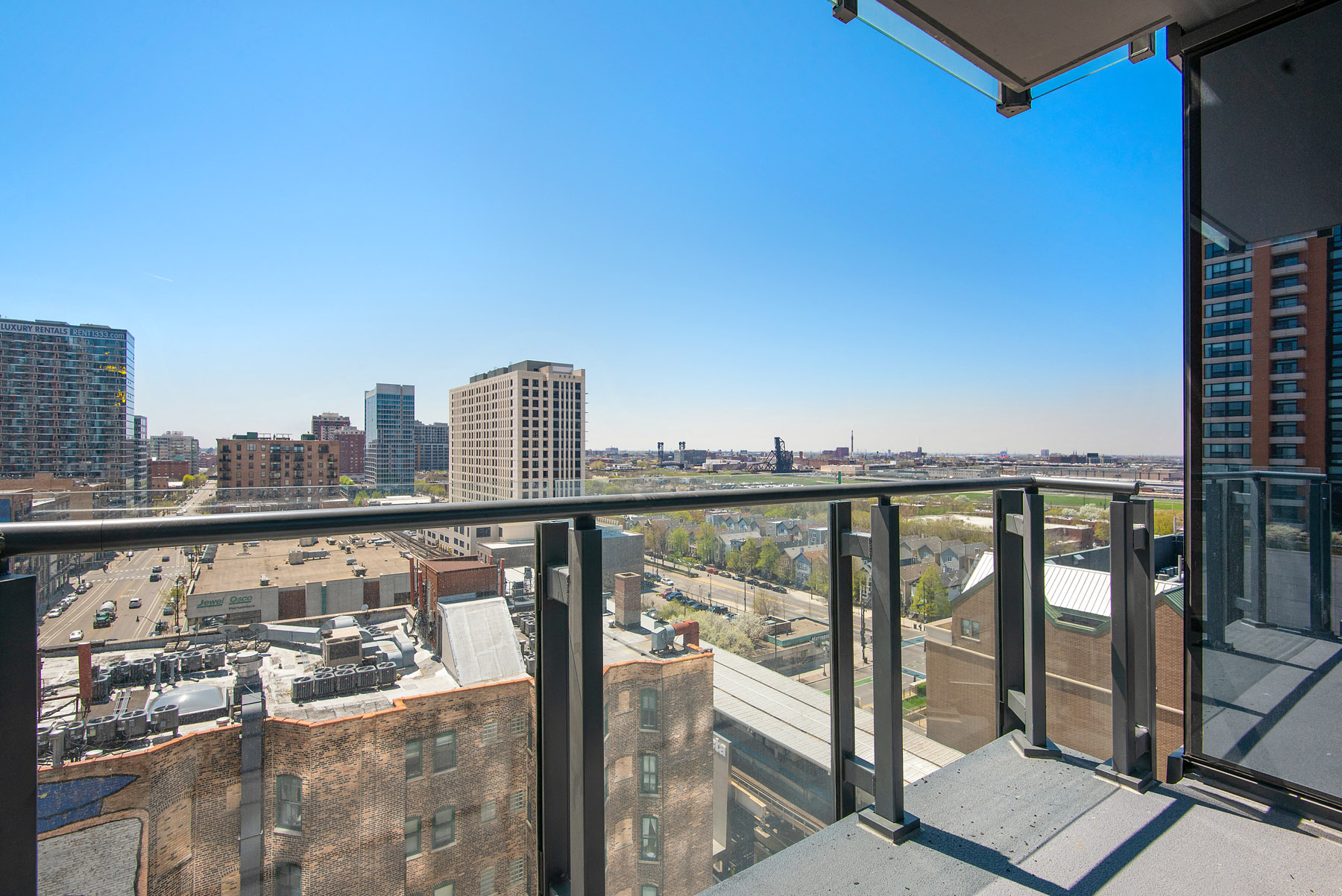 Private balcony overlooking the city at Eleven40, Chicago, IL, 60605