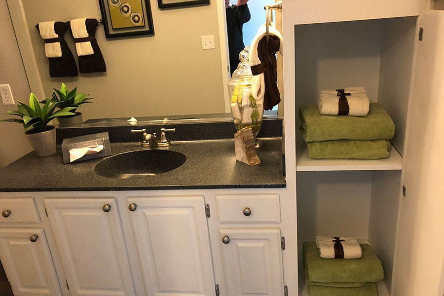 Westlake Greens bathroom white cabinets with black countertop