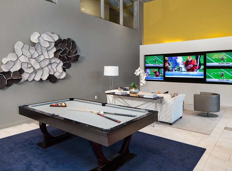 Resident Game Lounge with Billiards Table & Multiple TV Screens for Meetings & Viewing Parties at Park 35 on Clairmont Apartment Homes, 3500 Clairmont Ave. Birmingham, AL 35222