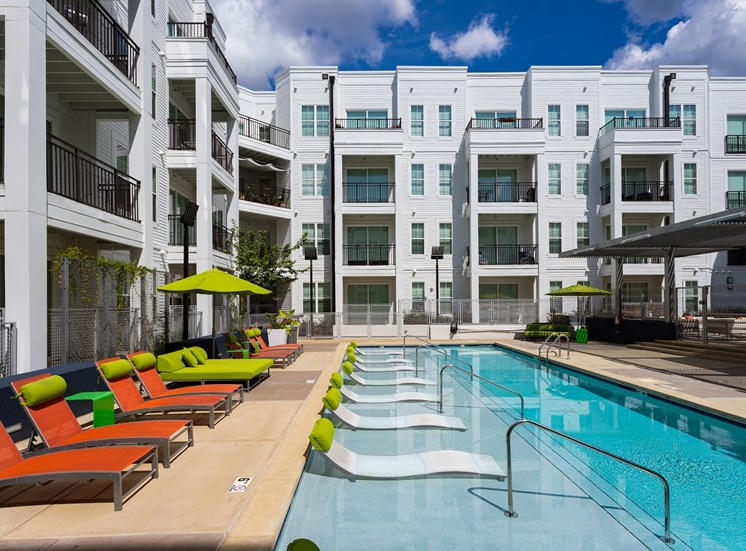 Luxurious Pool with Tanning Sun Shelf for Lounging and Enjoying the Sun at Park 35 on Clairmont Apartment Homes, 3500 Clairmont Ave. Birmingham, AL 35222