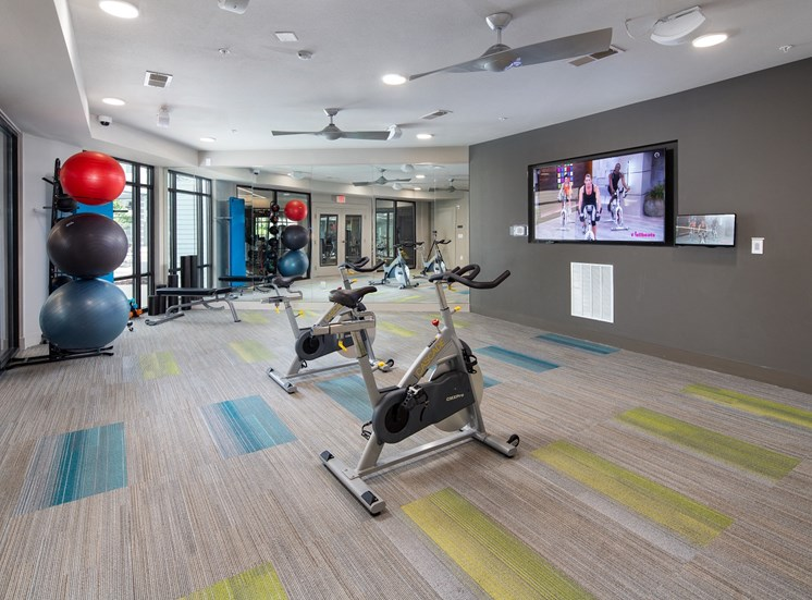 Fitness Center with On-Demand Video Access, Cardio Machines, Weight Training Equipment and Yoga Balls at Park 35 on Clairmont Apartment Homes, 3500 Clairmont Ave. Birmingham, AL 35222