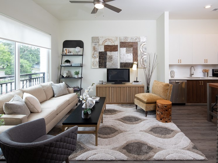 Gorgeous Living Space with Ceiling Fans and Wood Grain Plank Flooring in all Living Areas at Park 35 on Clairmont, 3500 Clairmont Ave. Birmingham, AL 35222