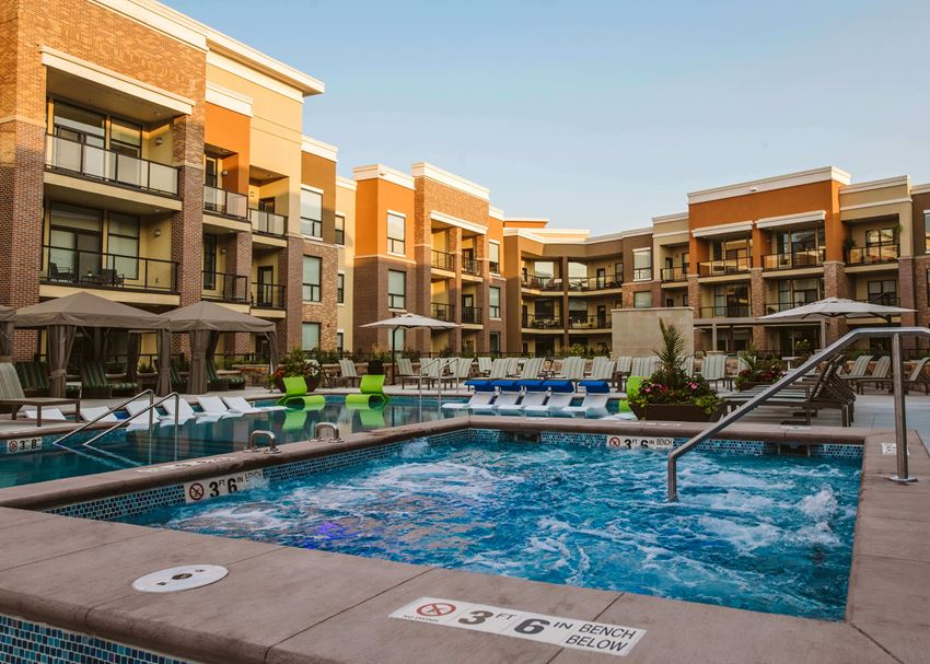 An outdoor pool at an apartment home complex