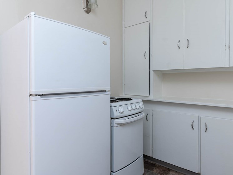 Palladian Apartments | White Kitchen Cabinetry and White Appliances