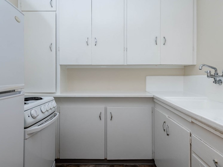 Palladian Apartments | White Kitchen Cabinetry and White Appliance Package