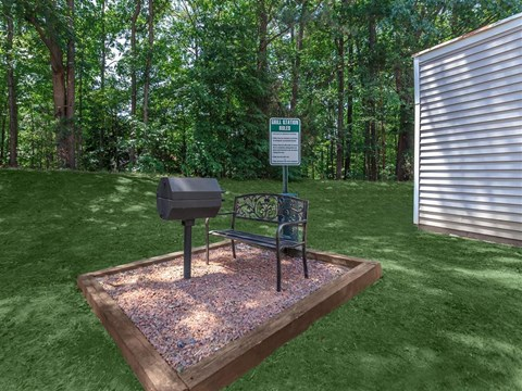 Chill With Your Friends At Outdoor Grill at Edwards Mill Townhomes & Apartments, North Carolina