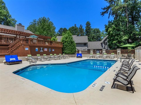 Poolside Sundeck With Relaxing Chairs at Edwards Mill Townhomes & Apartments, Raleigh, North Carolina