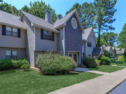 Lush Green Entrance Of The Property at Edwards Mill Townhomes & Apartments, Raleigh, North Carolina