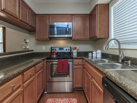 Fully Equipped Kitchen With Modern Appliances at Edwards Mill Townhomes & Apartments, Raleigh, NC, 27612