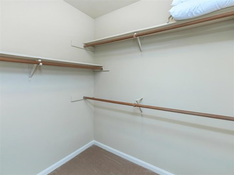 Walk-In Closets With Built-In Shelving at Edwards Mill Townhomes & Apartments, Raleigh, 27612