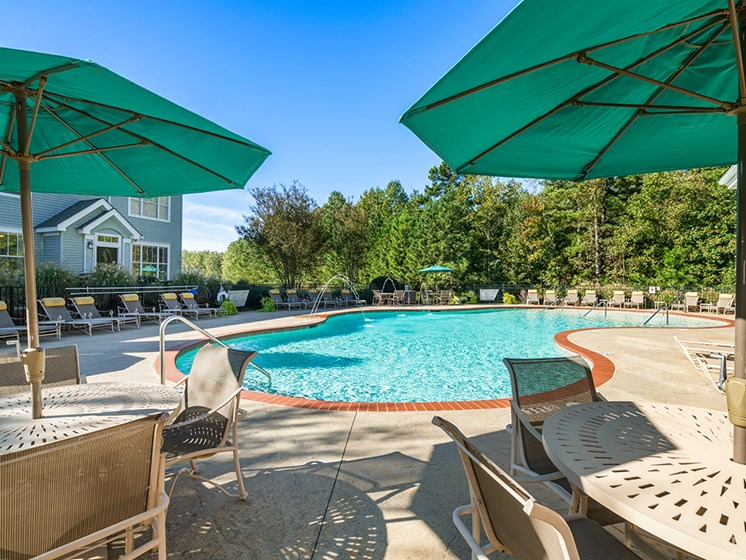 Umbrella Shaded Chairs by Pool at Millennium, Greenville, South Carolina