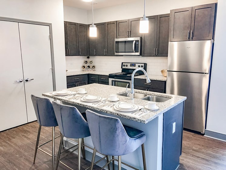 Fitted Kitchen With Island Dining at The Ivy at Berlin Place, South Bend, 46601