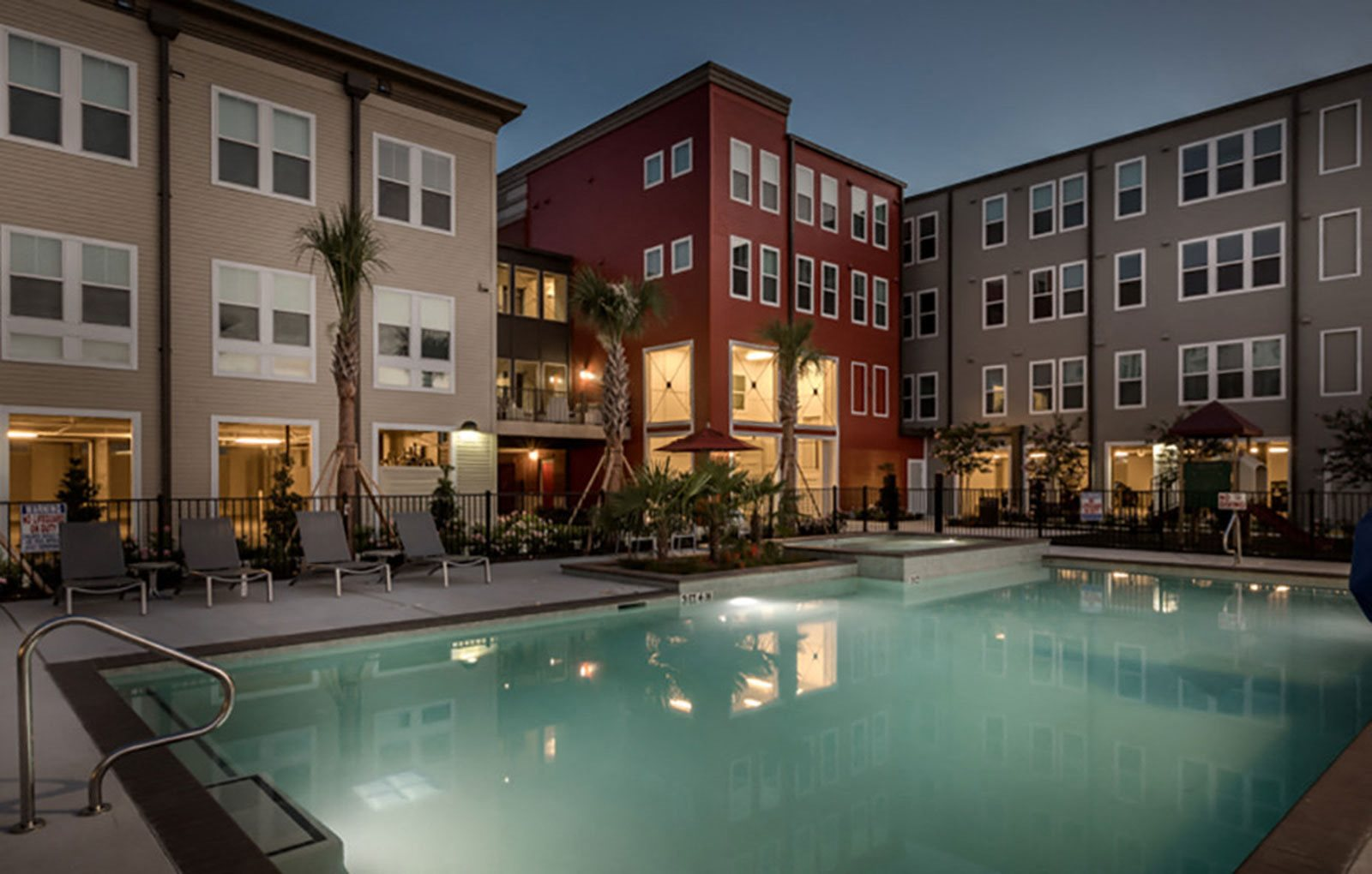 Outdoor swimming pool and pool area during dusk-Villas on the Strand, Galveston, TX 77550