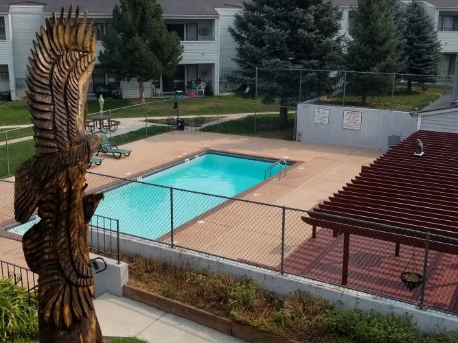 Indian Hills Apartments Pool Area and Eagle Totem Statue