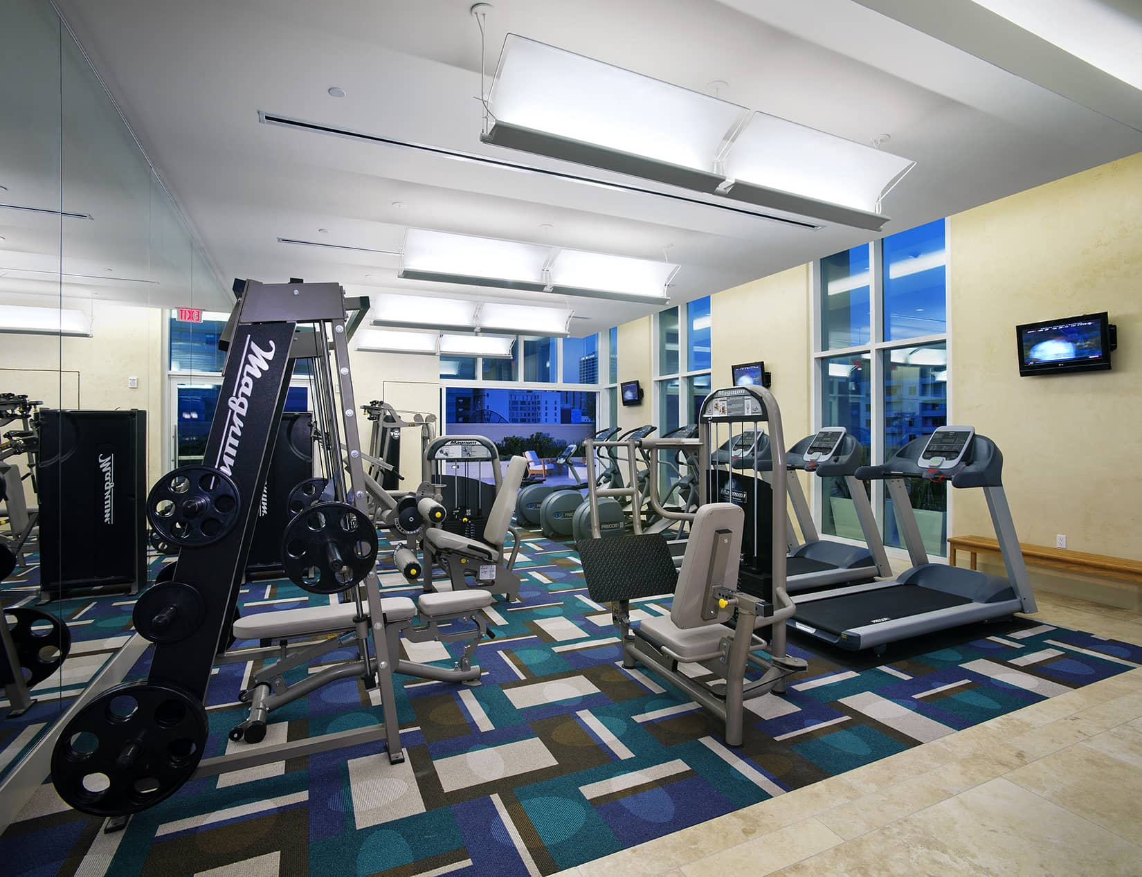 24 hour fitness center with weights and cardio equipment
