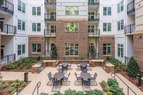 The Flats Exchange on Erwin | Community Grills and Relaxation Deck