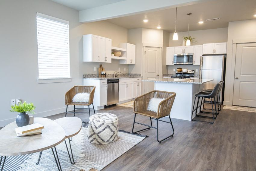 Model apartment home living room, dining room, kitchen with island