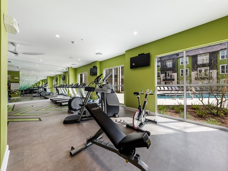 Cardio machine area overlooking the interior pool courtyard