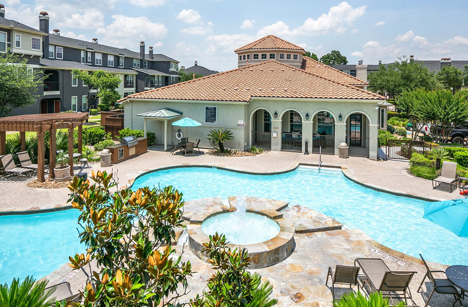 Pool overview at The Dominion Apartments in Conroe, TX