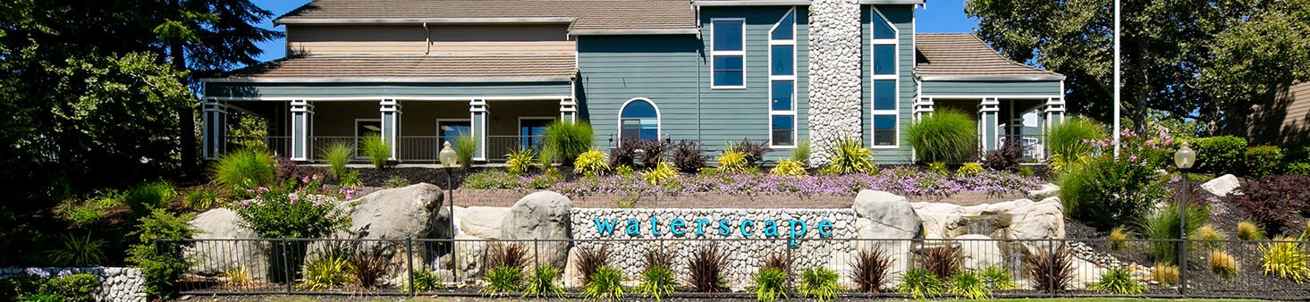Entrance sign l Waterscape Apartments in Fairfield CA