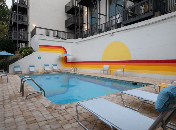 Renovated pool and sundeck with mural and new pool furniture