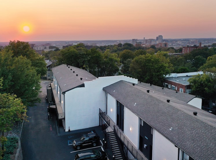Sunset overlooking city over Nova Highland Park Apartment Buildings