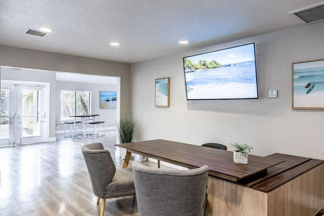 Leasing office desk and TV l Tides at Grand Terrace