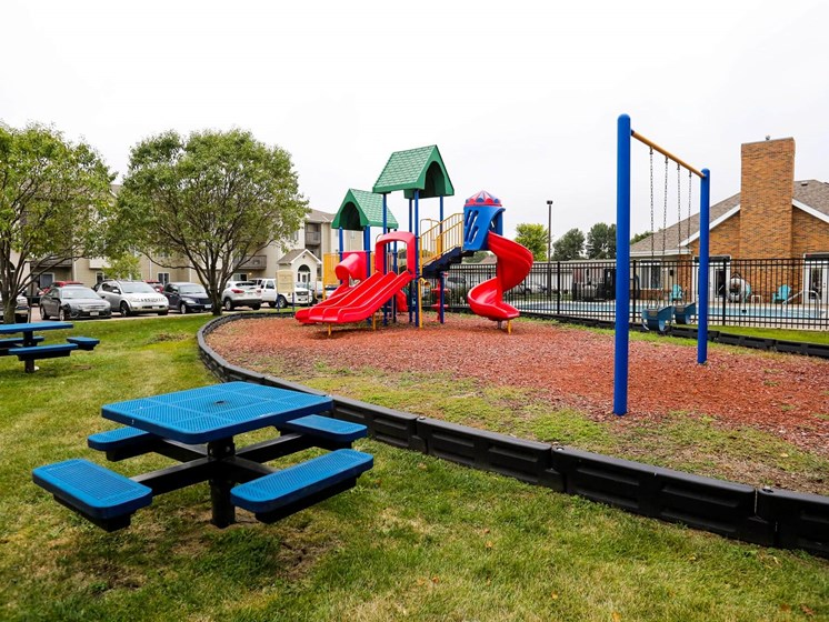 Playground with swings at The Arbors Apartments in South Sioux City, NE