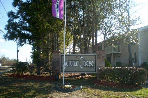 entrance signage and flag at Autumn Chase Apartments