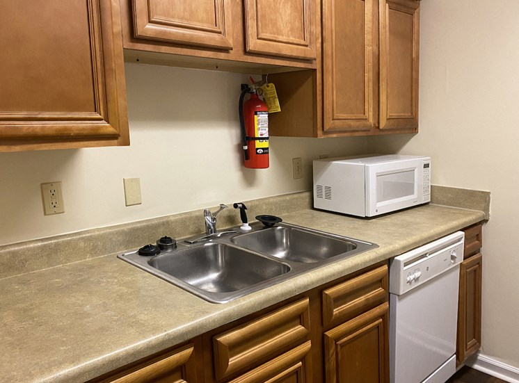 stainless steel sink and fire extinguisher in kitchen