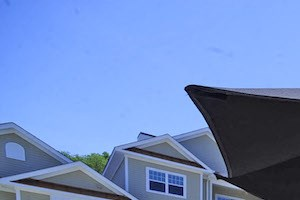 Fenwyck Manor Apartment Homes Chesapeake, Greenbrier VA 23320 outdoor table and umbrella