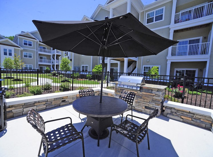 Fenwyck Manor Apartment Homes Chesapeake, Greenbrier VA 23320 outdoor table and umbrella